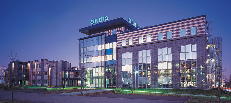 Exterior view of the main building of ORBIS AG at night